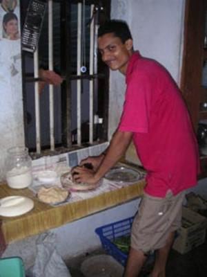 our_chef_making_chapatis_looking_at_camera_6_may